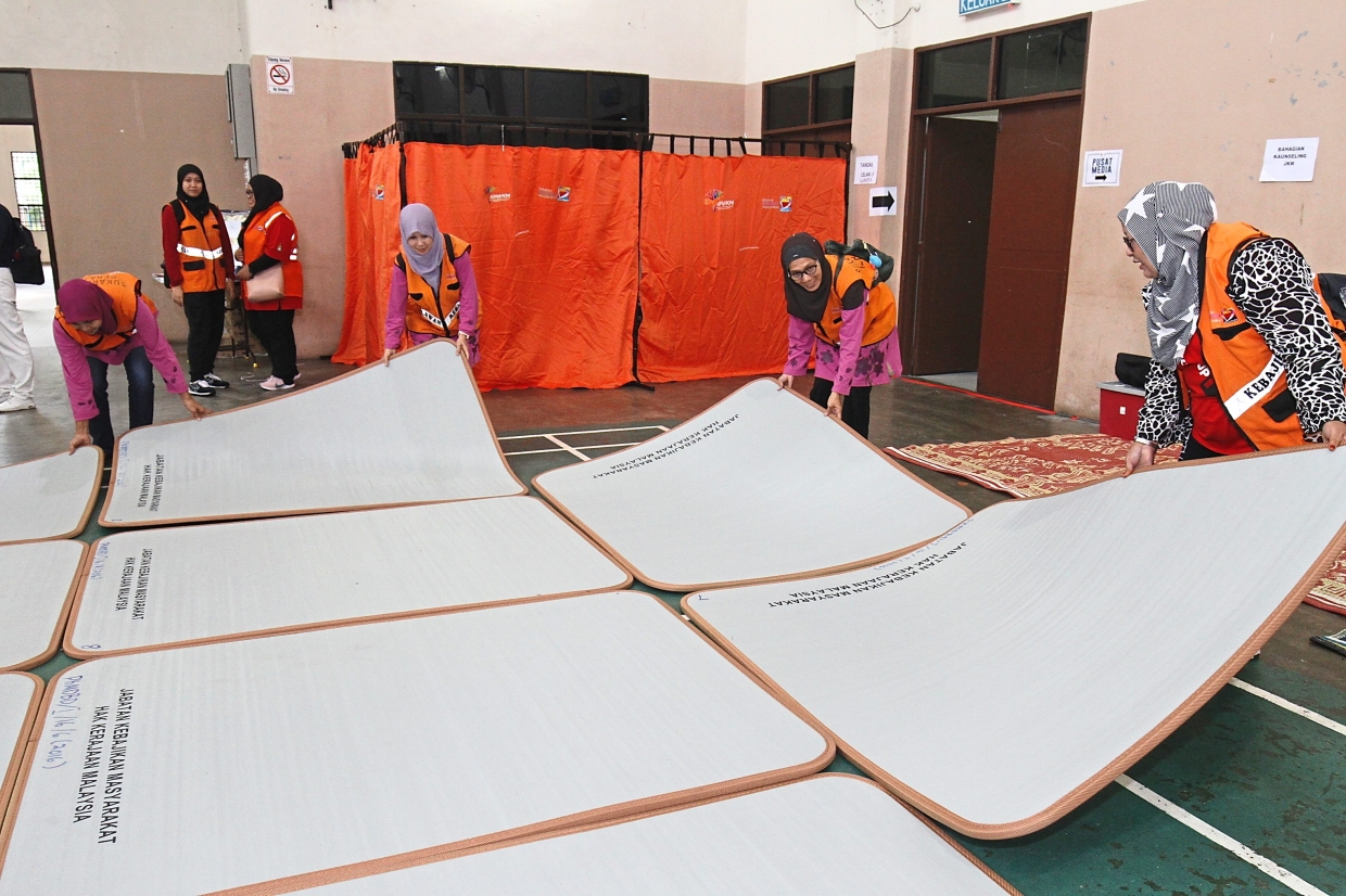 Mattresses being laid out for the residents taking part in the drill.