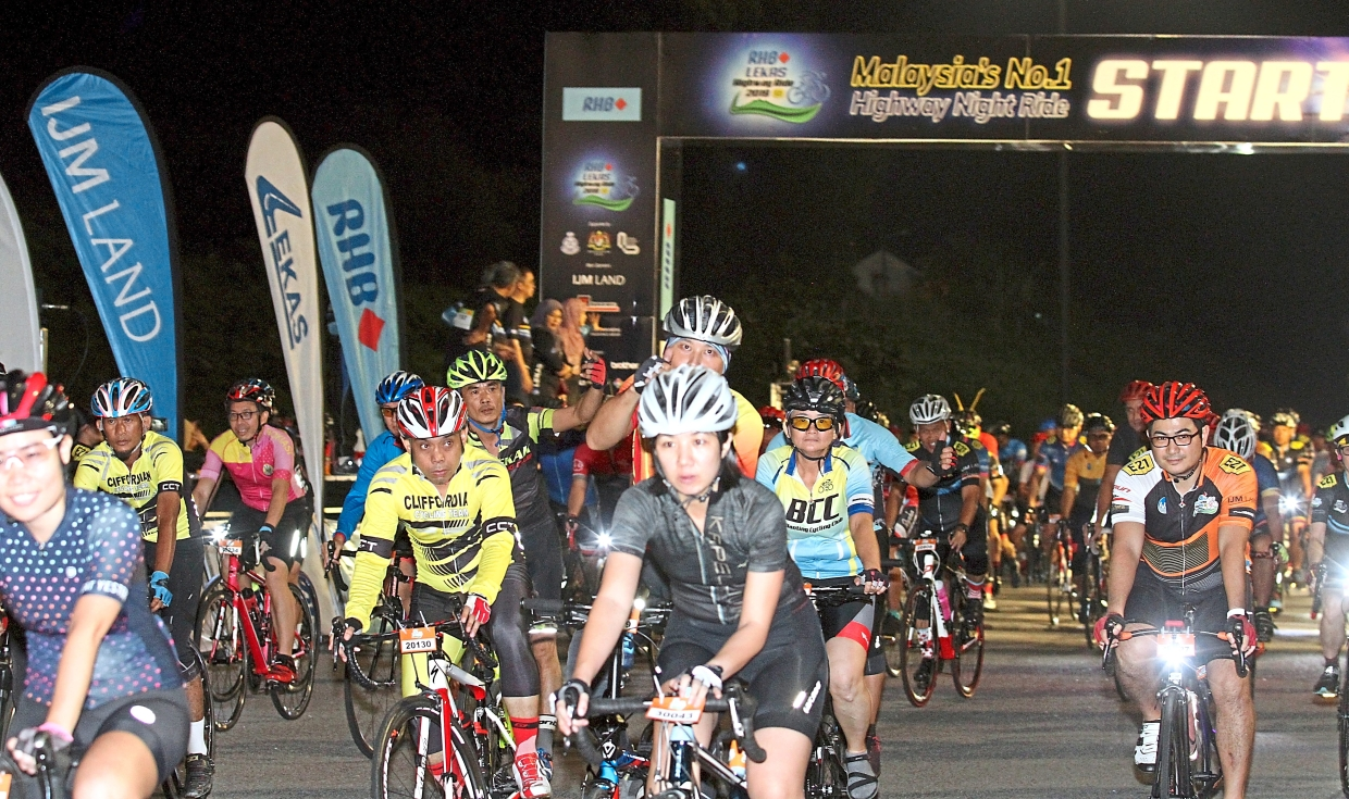 Cyclists from different categories being flagged off by the VIPs.
