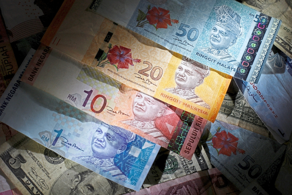 Uncertain times: Due to the ongoing global uncertainties, the ringgit is expected to trade between 4.1850 to 4.1950 against the greenback this week. — Reuters