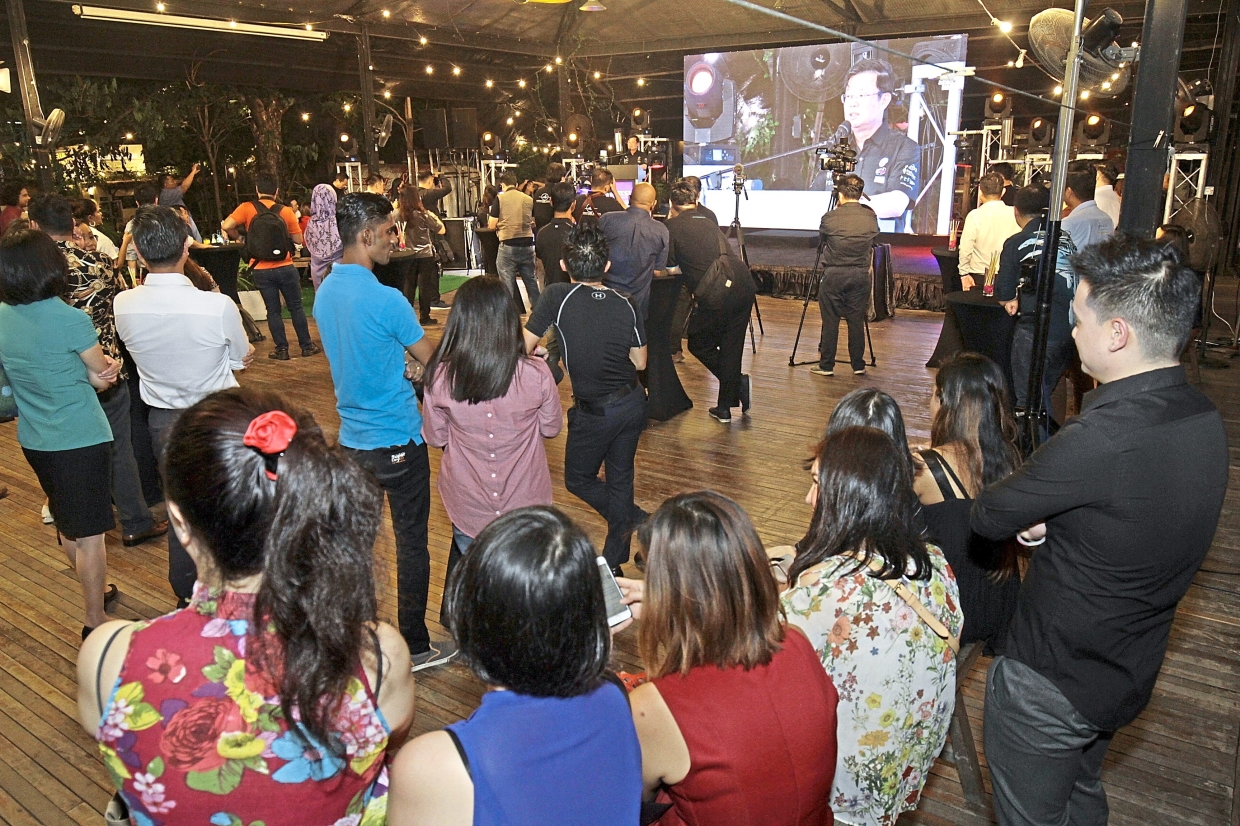 Guests watching the campaign launch on a big screen