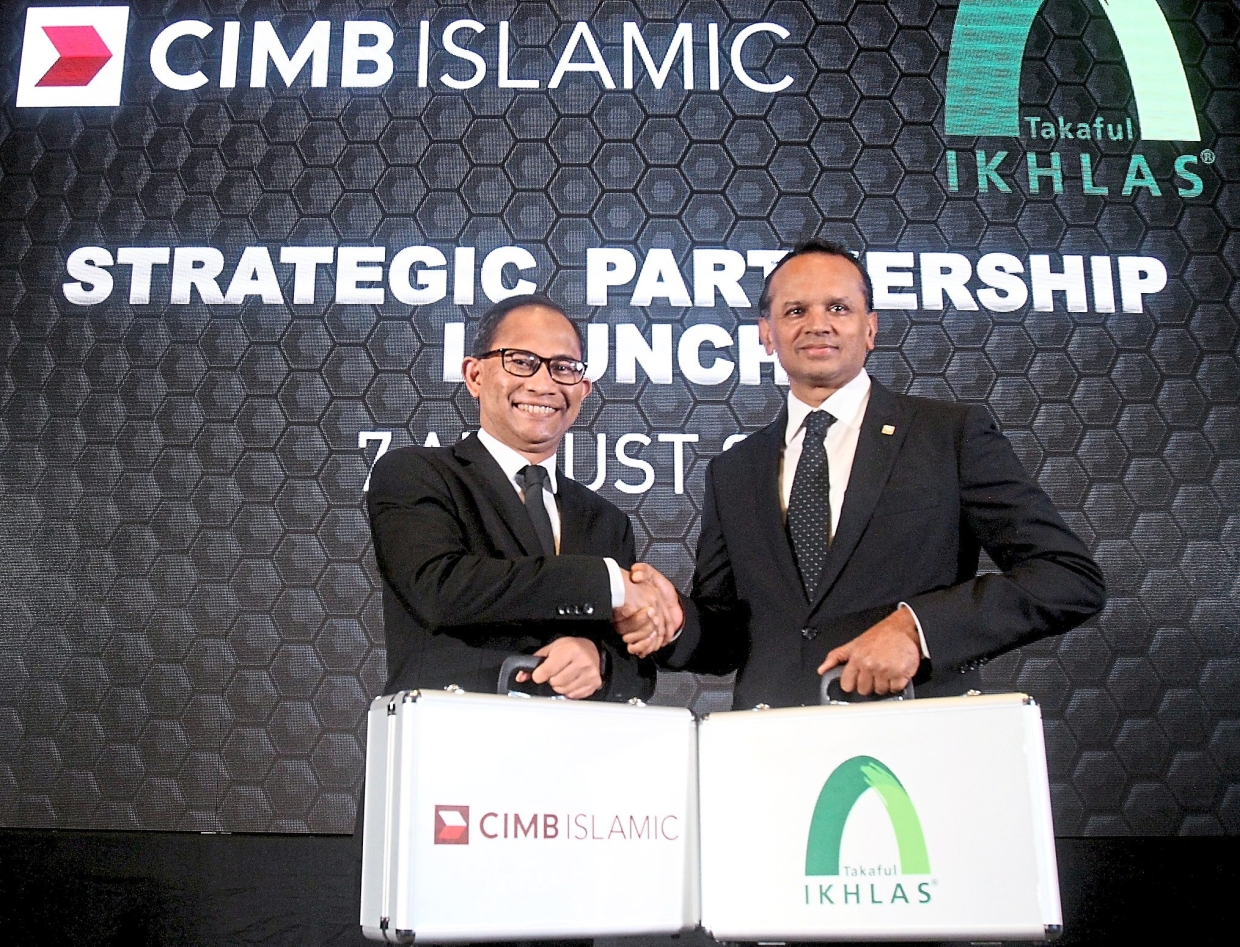 From left: Takaful Ikhlas General Bhd president and CEO Eddy Azly Abidin and CIMB Islamic Bank Bhd CEO Rafe Haneef, after launching the Strategic Partnership Between CIMB Islamic and Takaful Ikhlas.