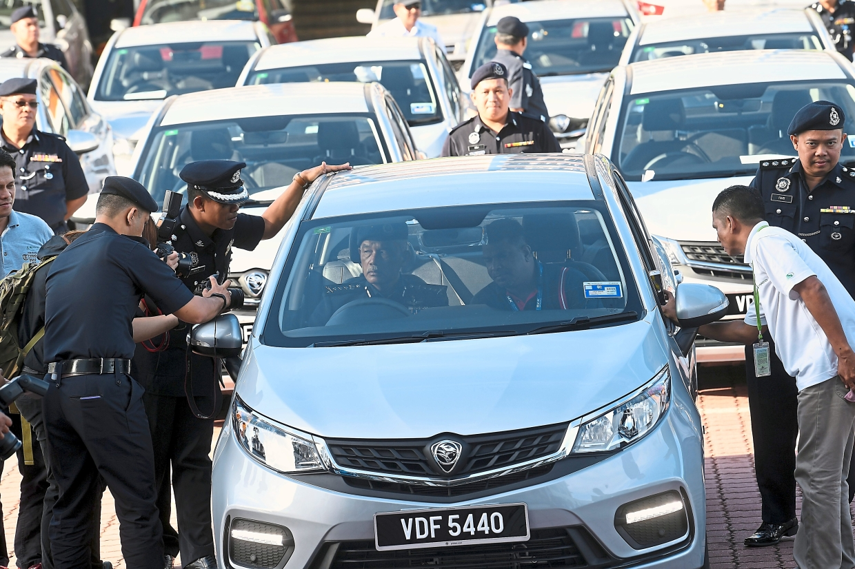 New cars for the force: The Kedah police contingent headed by its chief Datuk Zainuddin Yaacob checking out some of the vehicles delivered by Spanco at a handing over ceremony recently at the Kedah police headquarters. Spanco is the incumbent vehicle fleet contract holder for the government. — Bernama