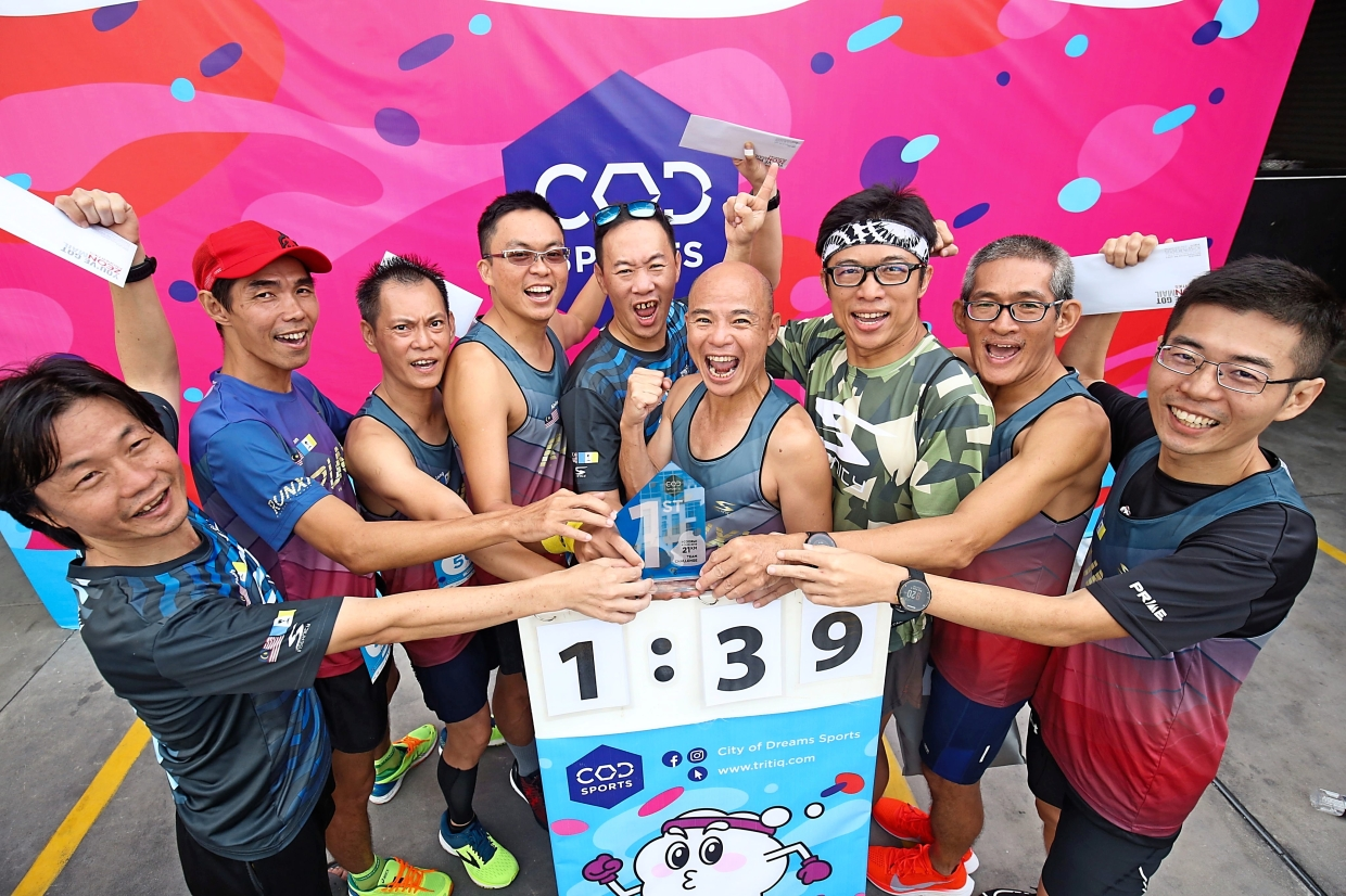 RunXi members celebrating their Team Challenge category victory.