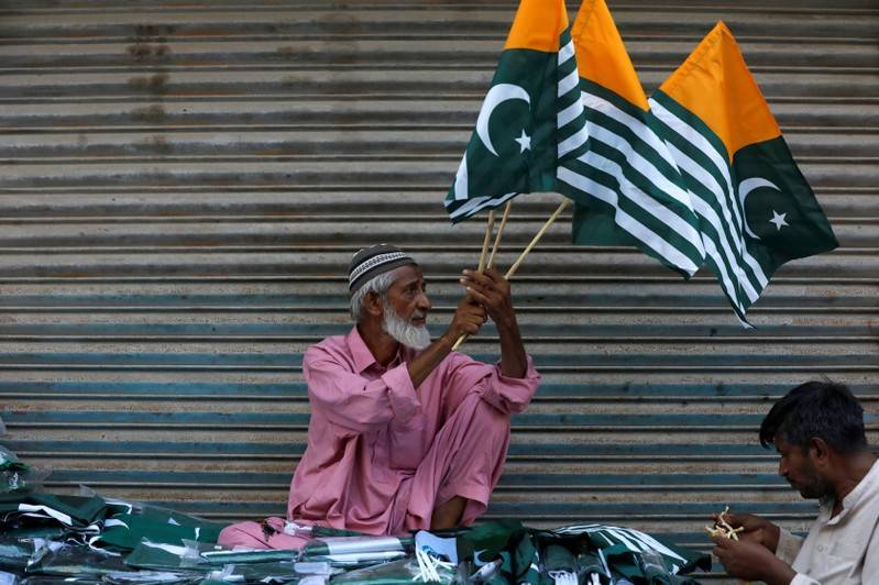 A man sells Kashmirs flags and patriotic memorabilia ahead of Pakistans Independence Day along a market in Karachi Pakistan August 13 2019. REUTERSAkhtar Soomro