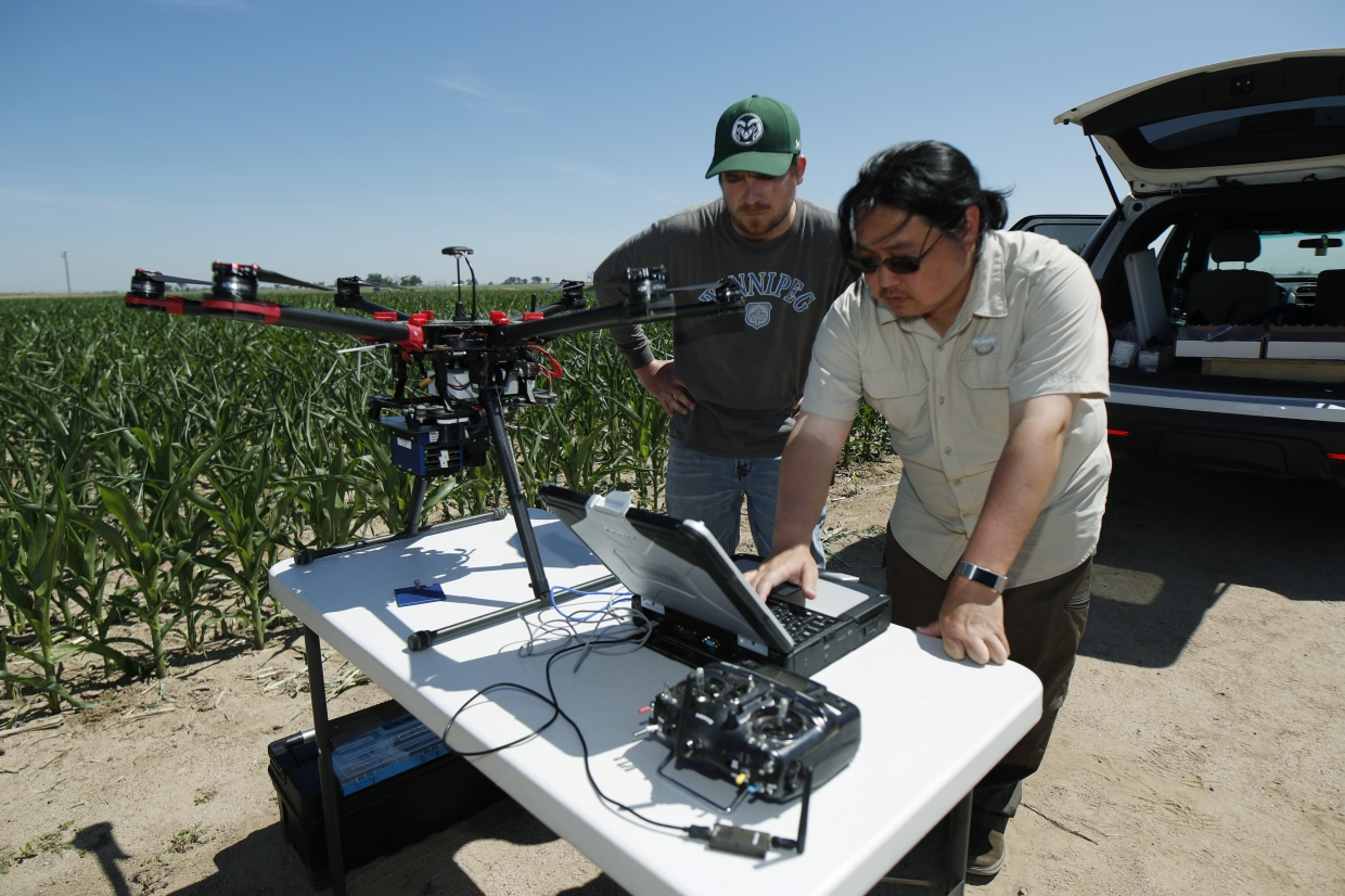 United States Department of Agriculture staffers setting up a drone for flight over a research farm northeast of Greeley, Colorado.