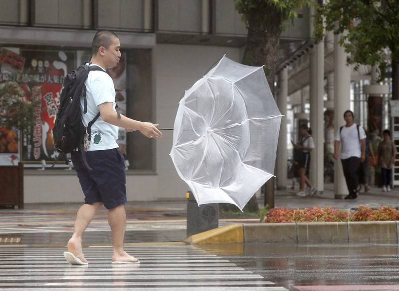 A man makes his way amid strong wind by typhoon Krosa in Miyazaki in this photo taken by Kyodo August 14 2019. Mandatory credit Kyodovia REUTERS Mandatory credit Kyodovia REUTERS