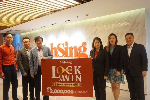 (From left) Mah Sing's Branding and Strategic Marketing general manager Bernard Yong, Sales and Marketing general manager Chris Chen, chief executive officer Datuk Ho Hon Sang, chief operating officer Everlyn Khaw, Sales and Marketing general manager Angela Chong and chief operating officer Yeoh Chee Beng unveiling the poster for the Lock and Win campaign.