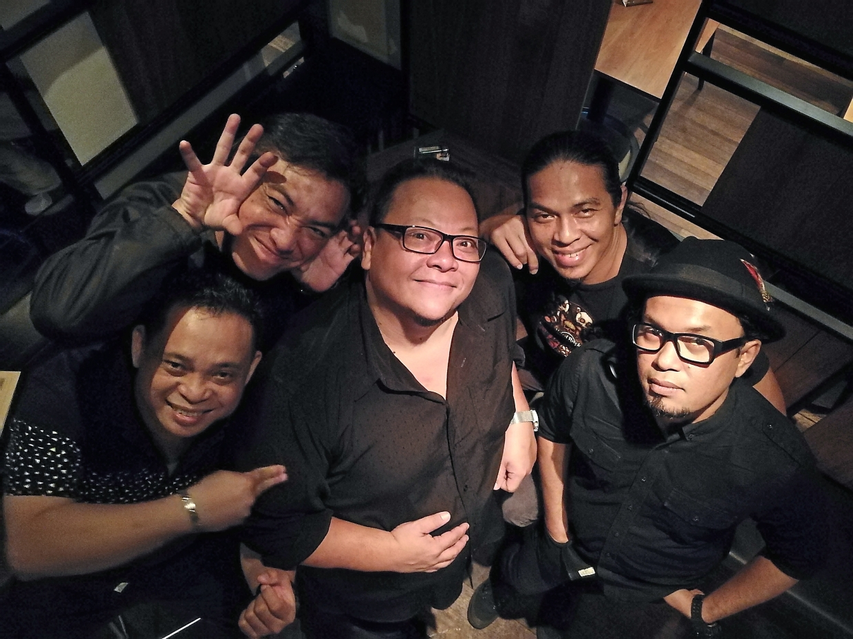 Sherman Tan (centre) brings some of his friends along for a ride as he jams up a storm in Holiday Villa's Little Cuba on Friday nights