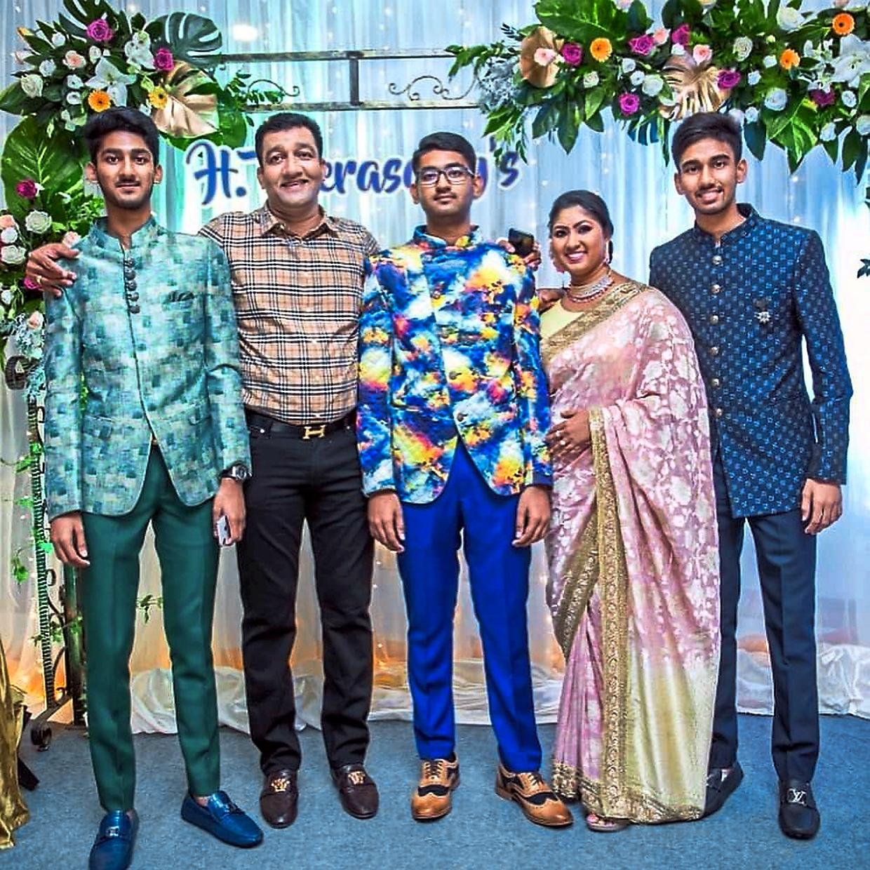 Harikrishnan (chequered shirt) with wife Puvaneswary and their children Veerasamy (middle), Mehgulan (polka dot blazer) and Navinsamy (green blazer) in happier times.