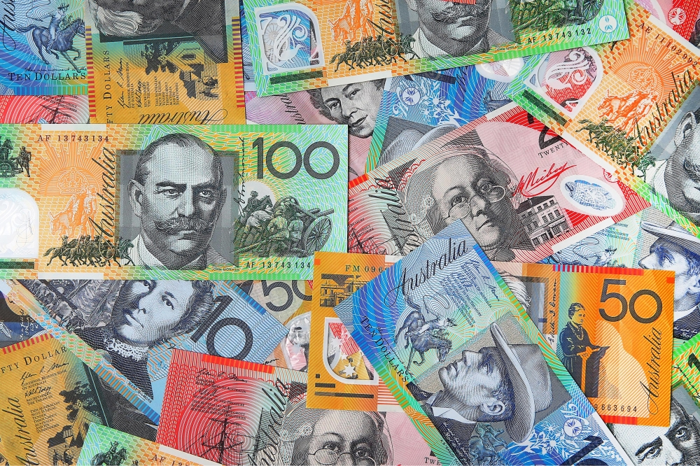 Australian dollar banknotes of various denominations are arranged for a photograph in Sydney, Australia, on Thursday, July 24, 2015. The Australian dollar slumped last week as a gauge of Chinese manufacturing unexpectedly contracted, aggravating the impact of declines in copper and iron ore prices. Photographer: Brendon Thorne/Bloomberg