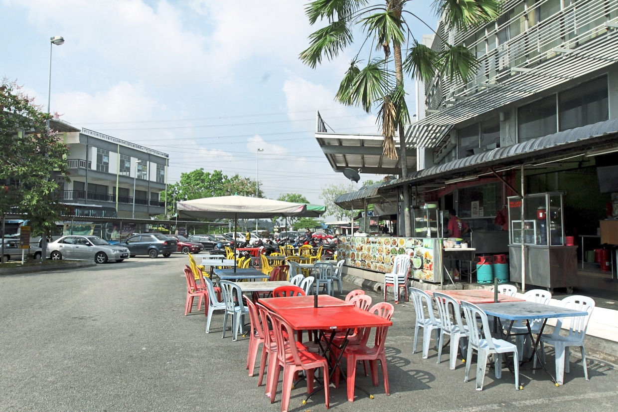 Foreigners have opened food stalls in front of the terminal and put tables and chairs on the parking bays.