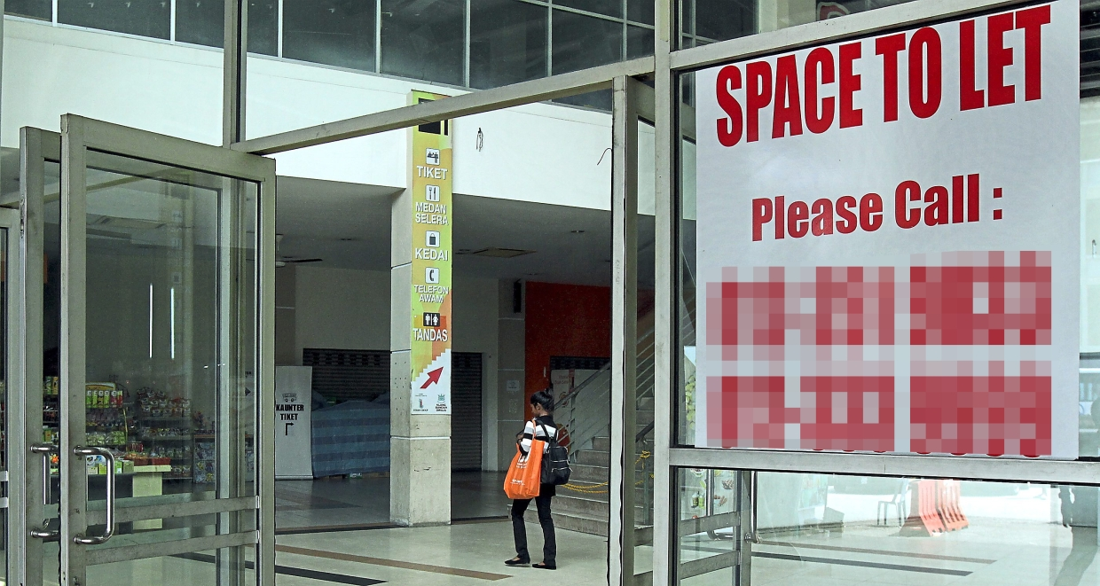Shops inside Klang Sentral are shuttered and the place is deserted. (Right) Shamsul, who runs a shop at Klang Sentral, says the bus terminal needs immediate repairs.