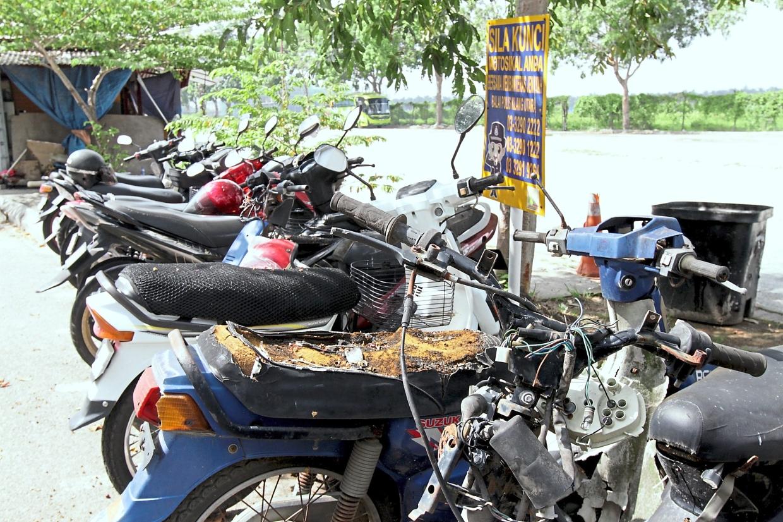 Motorcycles parked outside Klang Sentral bus terminal often get vandalised.