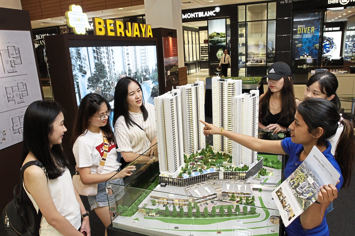 Good demand: Visitors viewing a scale model of The Tropika project. The current take-up rate for Tower A is 70%.