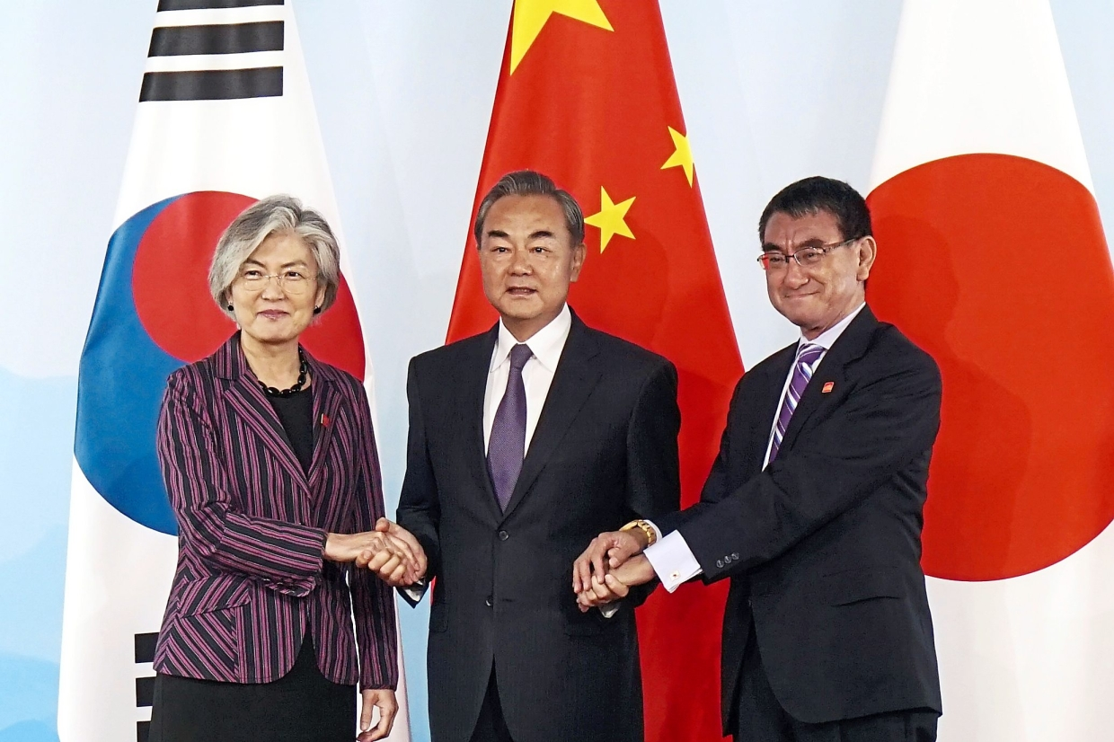 Trilateral talks held with S. Korea and Japan