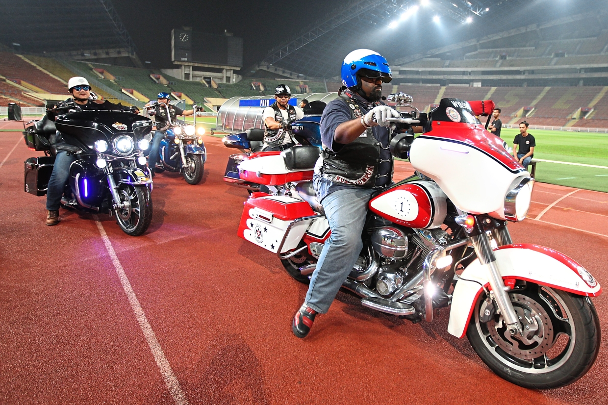 Members of the Kingz Motorcycle Group with their Harley-Davidson motorcycles taking part in the rehearsal for The Sultan of Selangor's Cup 2019.