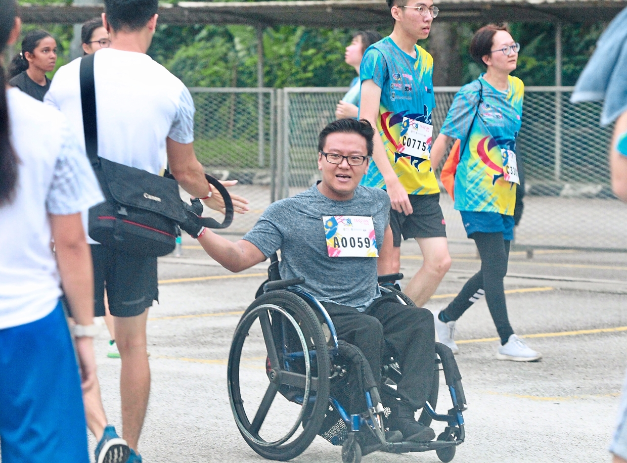 Wheelchair-bound Lee completed a 11km run during the TARCian Run 2019 in Kuala Lumpur last Sunday.