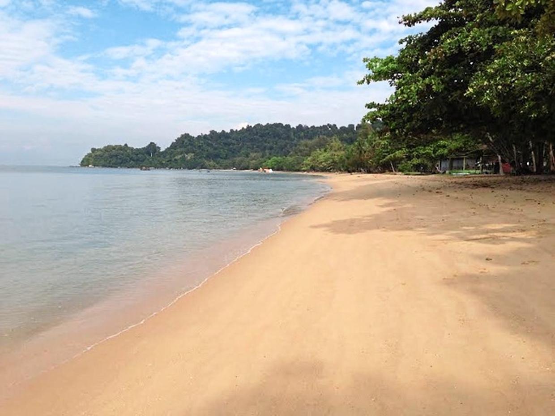 A tranquil scene of the island's Pasir Bogak beach