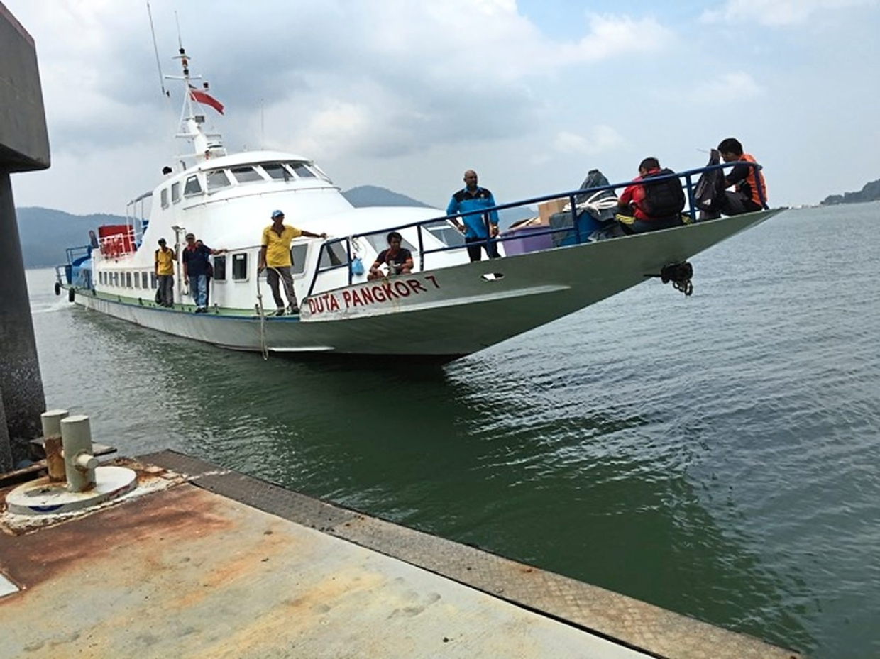 A ferry plying between coastal town Lumut to Pangkor's main jetty.
