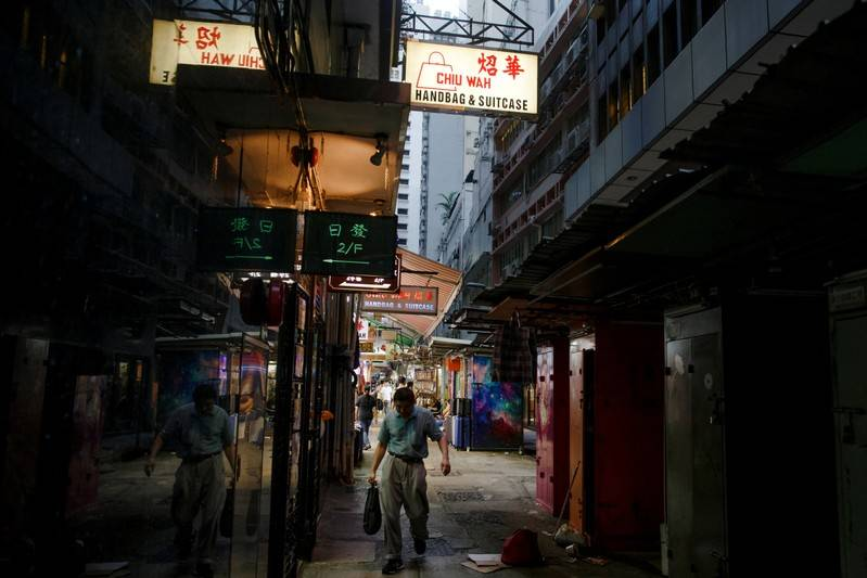 Battered Hong Kong faces economic recession, existential
