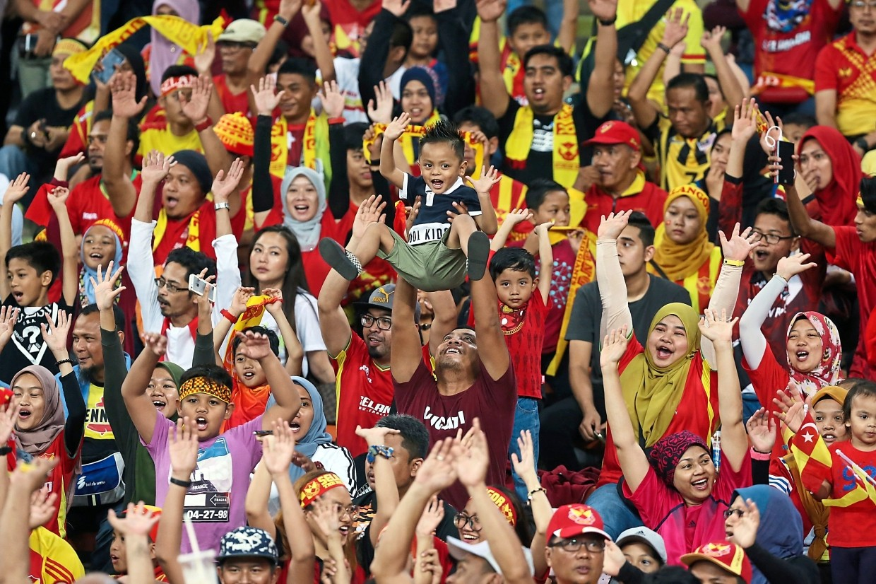 Hordes of Selangor (above) and Singapore (left) fans, both young and old, having a blast at the event.