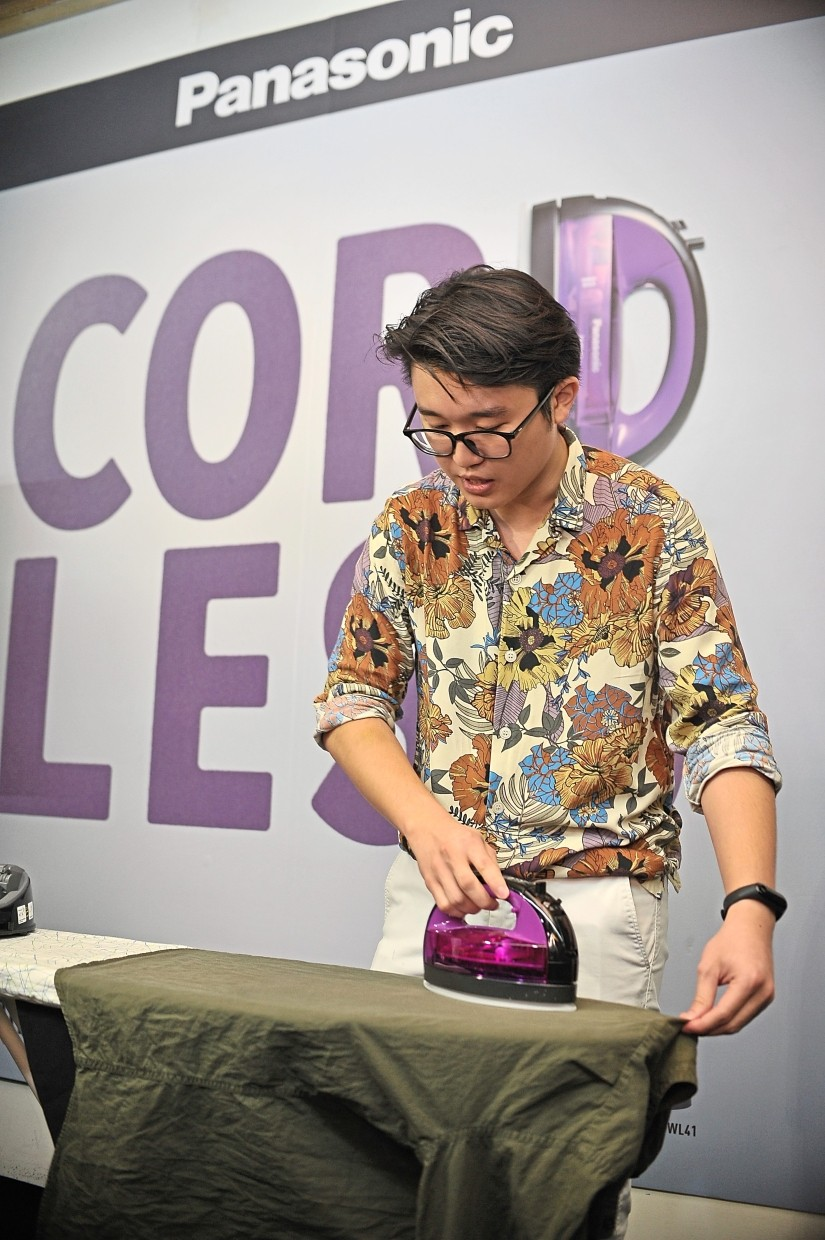 Panasonic Malaysia home appliances marketing executive Daniel Ling showing the newly launched Panasonic Cordless 360° Freestyle Steam Iron's capabilities.