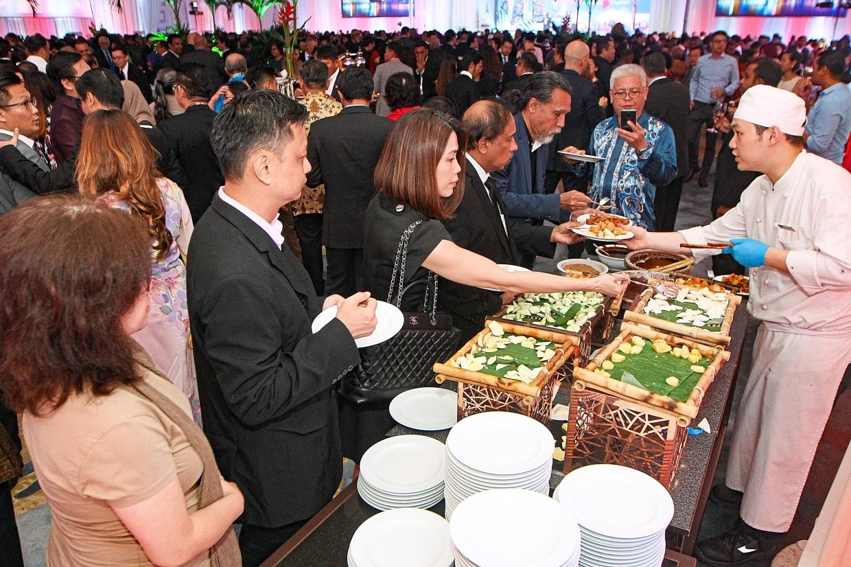 Guests helping themselves to food at the reception.