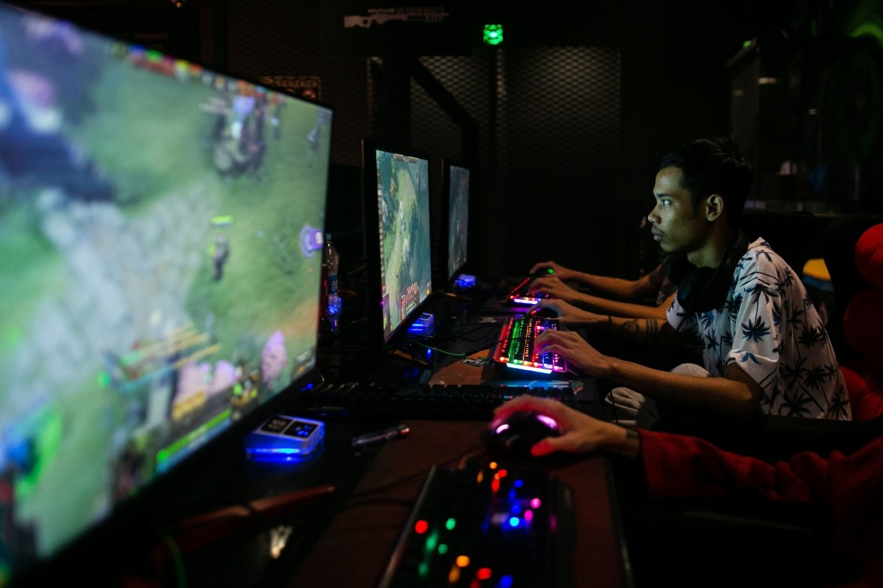 eSports player Myint Myat Zaw, also known as 'Insane', playing Dota 2 at an Internet cafe in Yangon.