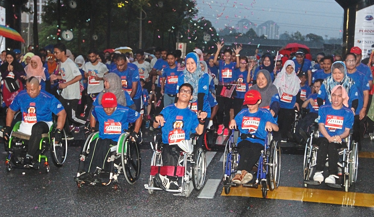 The fun run category included disabled participants in wheelchairs.