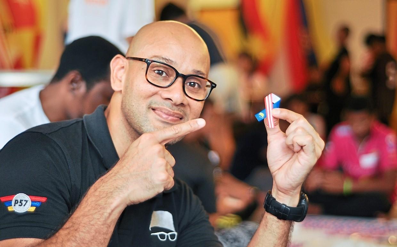 Symbol of harmony: Syed Sadiq showing the handmade unity ribbon.