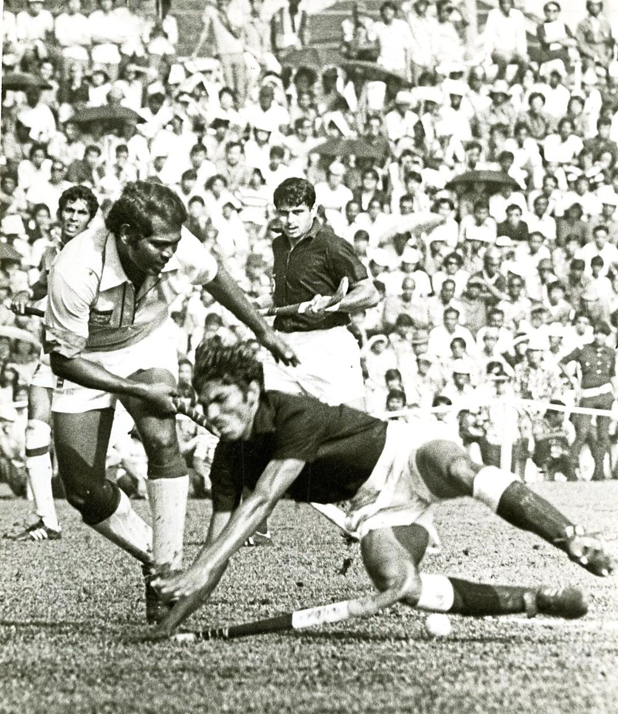 Malaysia's Datuk Seri N. Sri Shanmuganathan (left) stops a Pakistan player during the 1975 World Cup.