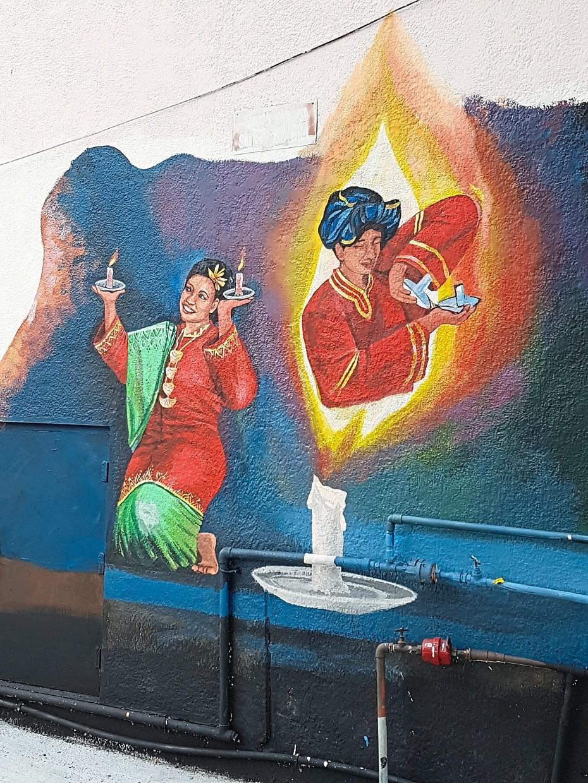 Some murals celebrate traditional tarian lilin dancers.