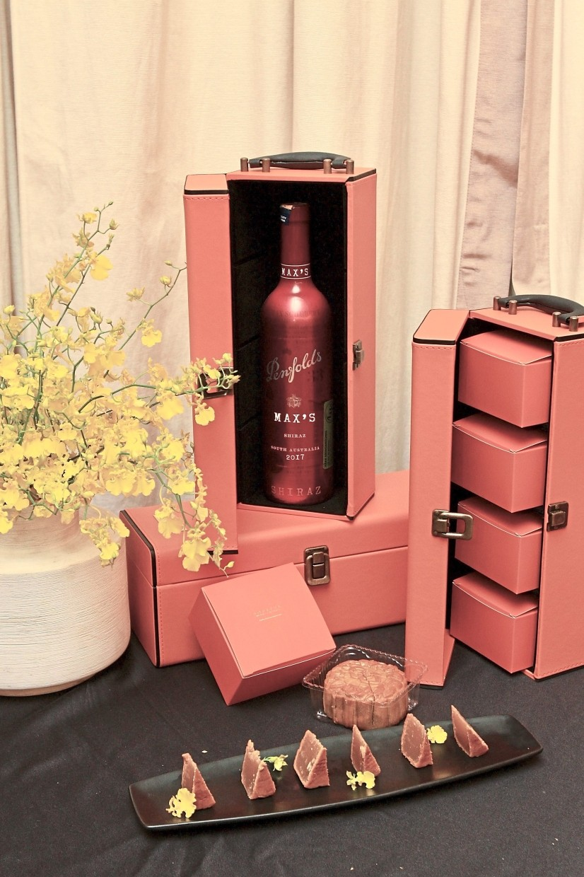 Sofitel's elegant tall boxes that can be turned into wine cases comes in third in the Best Packaging category.