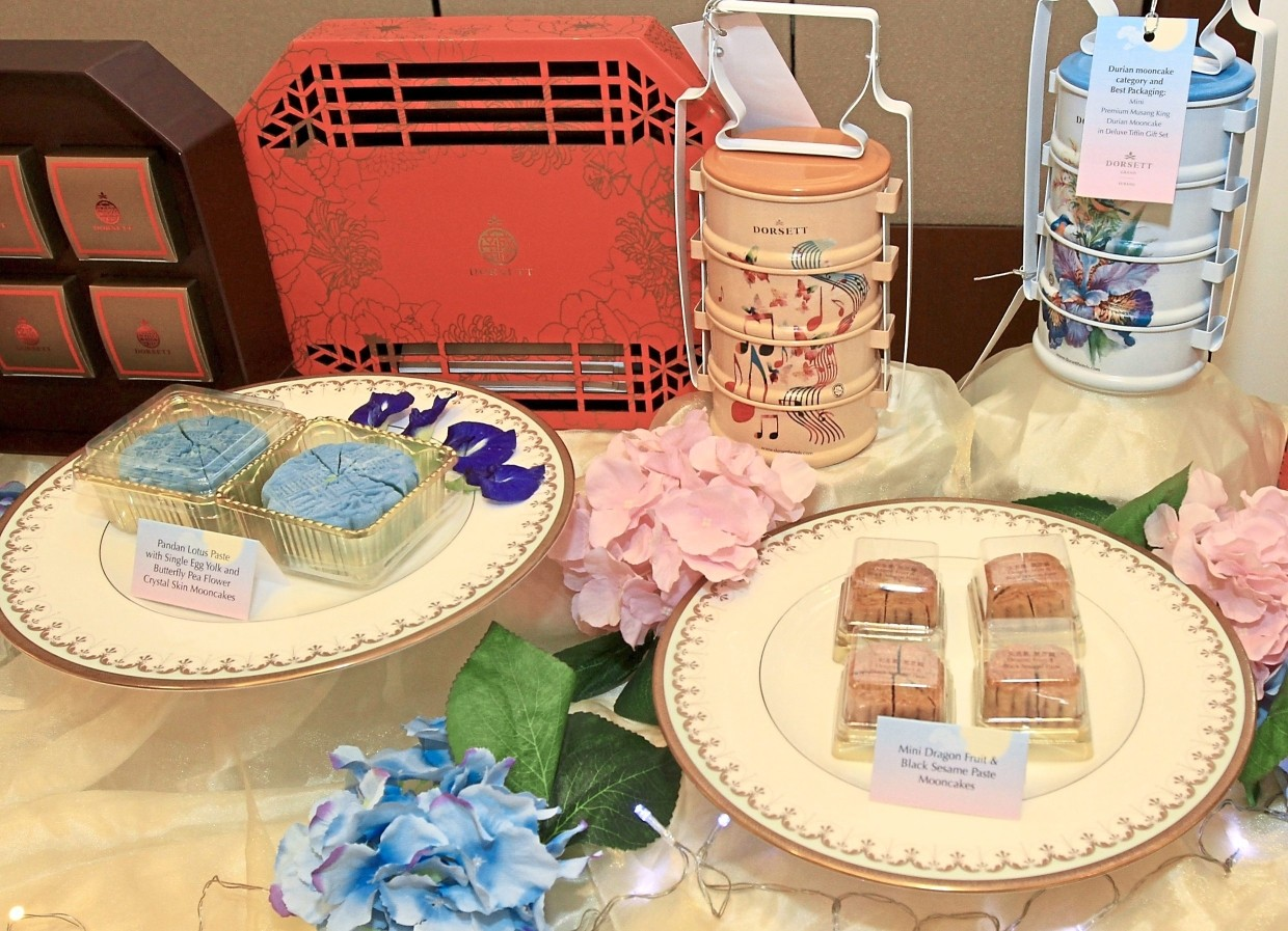 Dorsett Grand Subang takes the top prize in two categories – Snow Skin with its Dorsett Blue Mooncake (bottom left) and Best Packaging with its pretty tiffin carriers (top right).