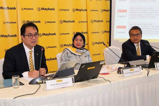 (from Left) Group President & CEO Maybank, Datuk Abdul Farid Alias, Chairman of Maybank, Datuk Mohaiyani Shamsudin and Group Chief Financial Officer Maybank, Dato' Amirul Feisal Wan Zahir at the Maybank Group First Half FY19 financial results announcement yesterday.
