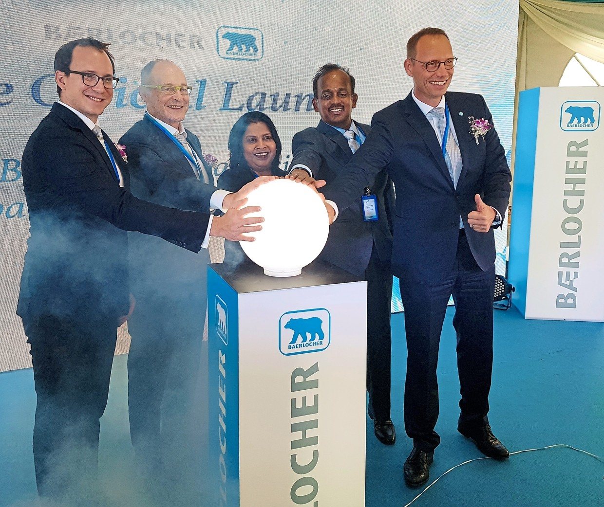 Opening ceremony: Talagavathi (middle) placing her hand on a crystal ball to symbolically open the new production line, warehouse and office building at Baerlocher Malaysia. Joining her are (from left) majority shareholder of Baerlocher Group of Companies Dr Tobias Rosenthal, advisory board chairman Dr Micheal Rosenthal, Sethu and Schulle