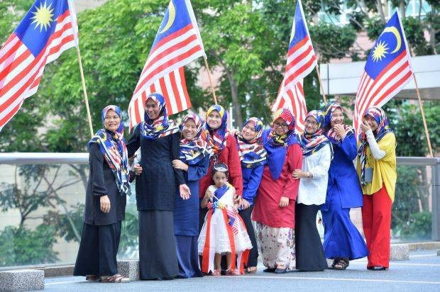 Ministry of Health Professional Promotion Unit,Human Resource Division staff turn up to work today clad in their Jalur Gemilang motif head scarfs to get into the Merdeka day mood which is tomorrow, Putrajaya, Friday, August 30, 2019. RAJA FAISAL HISHAN/The Star