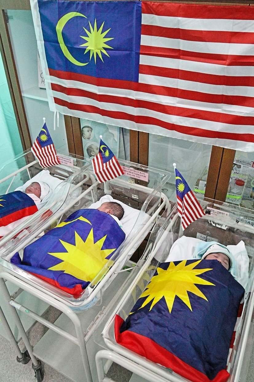 The three Merdeka babies who were born on Merdeka Day at Penang Hospital.  - Pic by:CHAN BOON KAI/The Star.