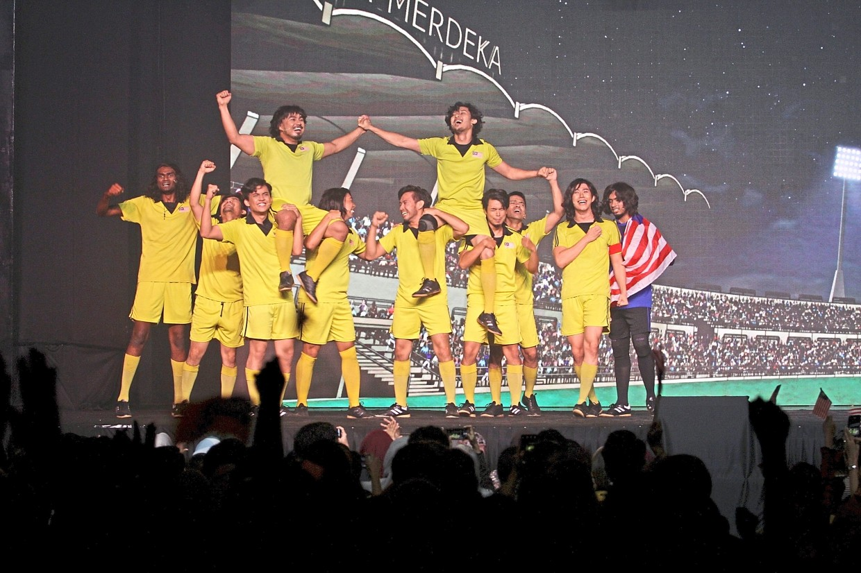 The 'Malaysian team' celebrating after their victorious performance.
