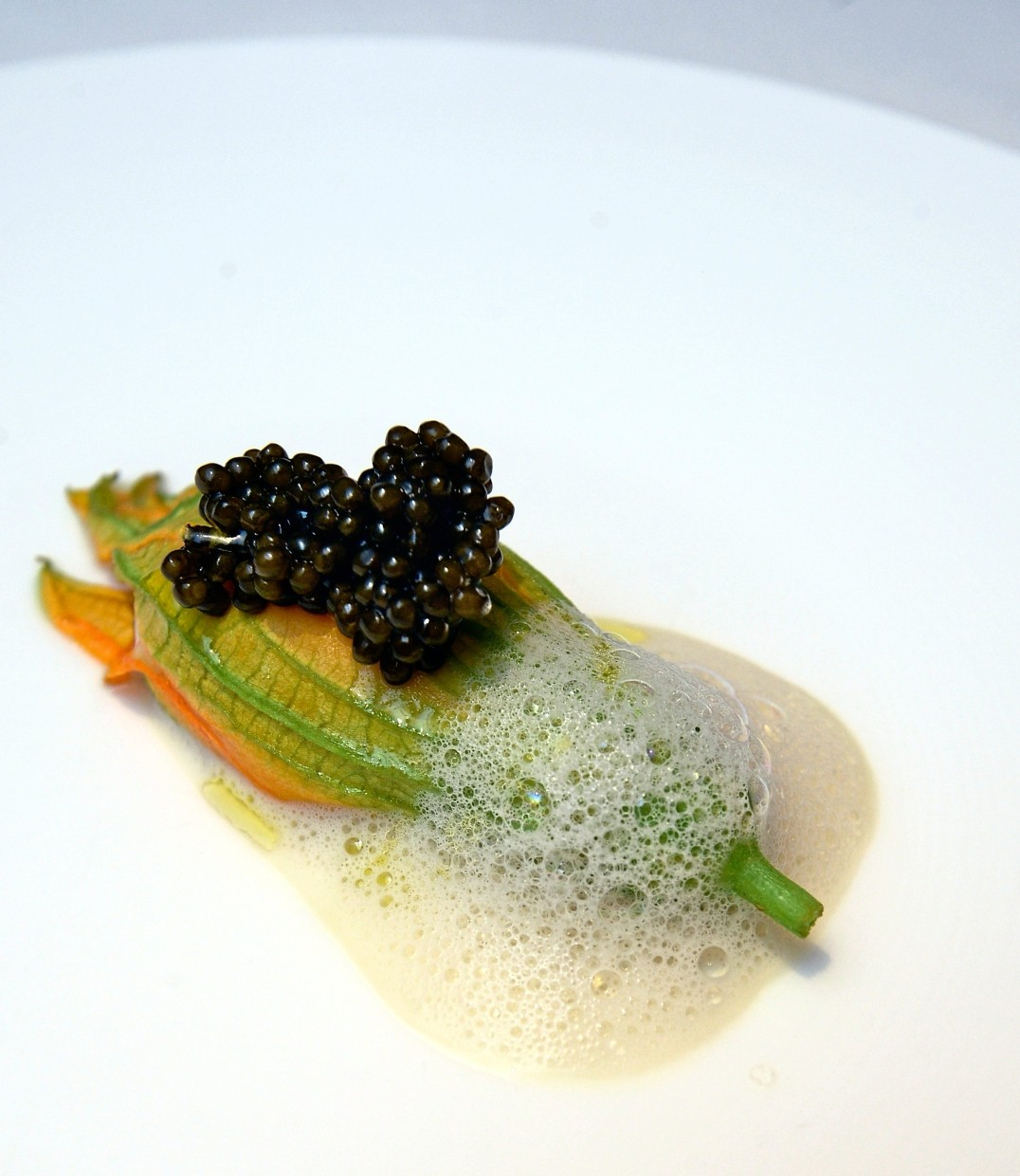 Zucchini flower with anchovy  mousseline and Oscietra caviar .