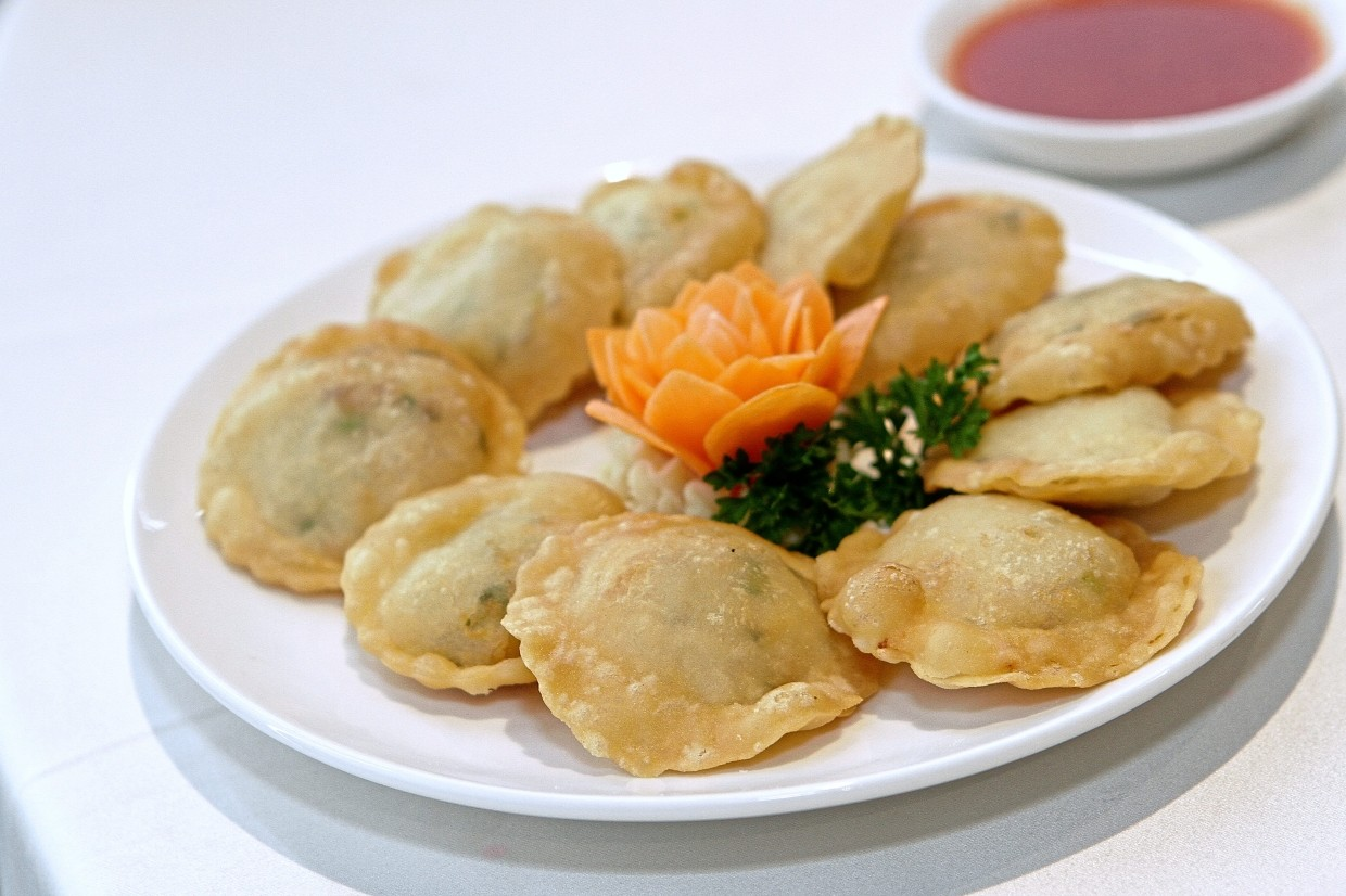 Macau Crab Meat Cake bears a close resemblance to curry puffs but with a twist.