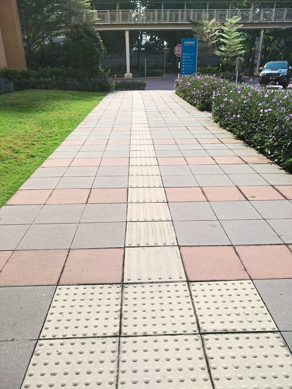 There is tactile paving on walkways and sidewalks throughout Sunway University.