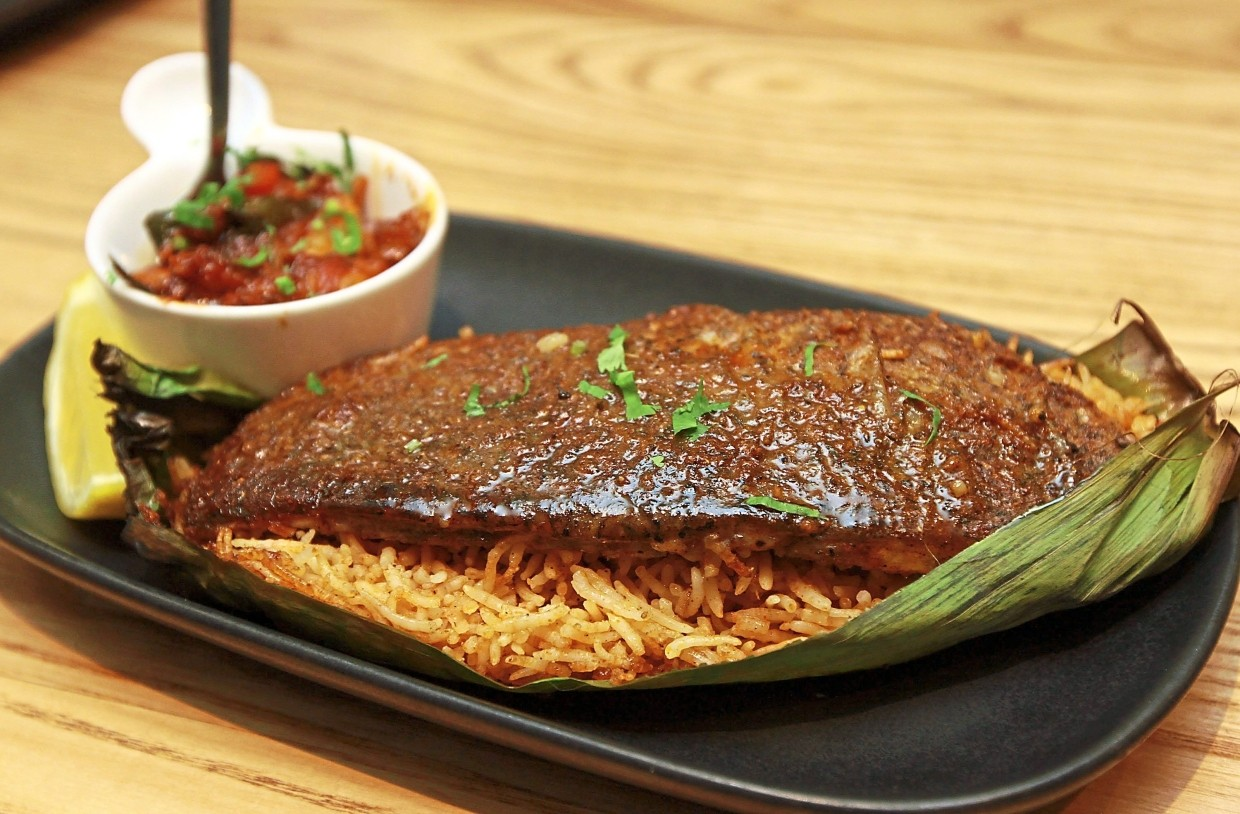The Banana Leaf Baked Seabass is a hearty serving of fish with fragrant basmati rice.