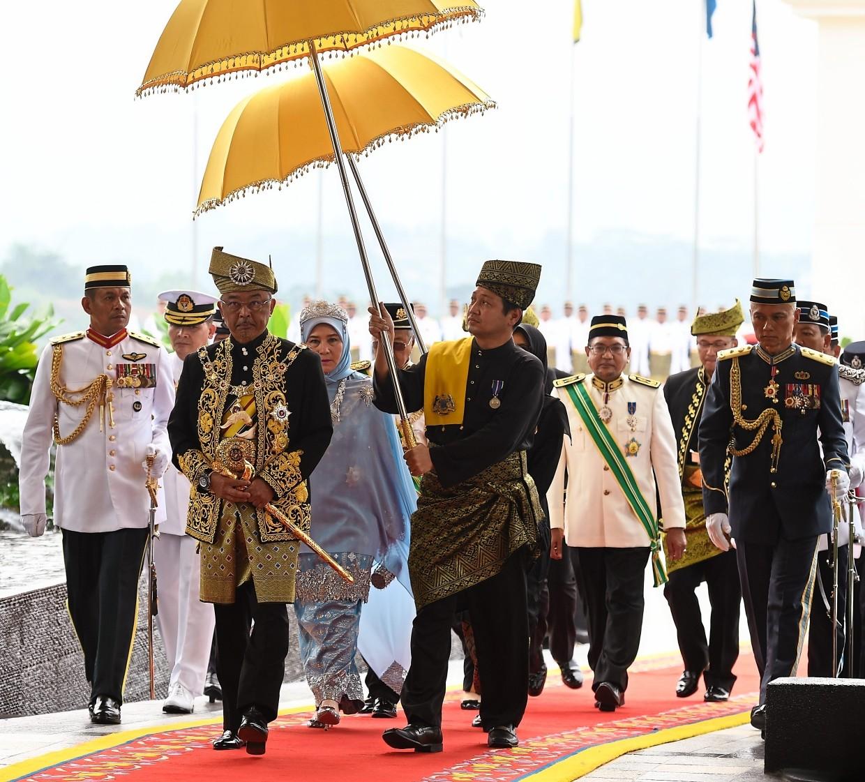 Royal arrival: Sultan Abdullah walking with Raja Permaisuri Tunku Hajah Azizah at Istana Negara in Kuala Lumpur. — Bernama