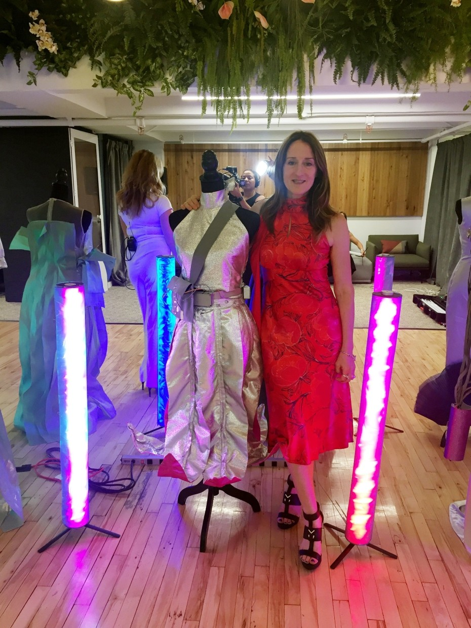 Tattersall posing with some of her creations her at the Robotic Dress Exhibition on September 9, 2019 in New York. Perfect for the post #MeToo era, on the catwalks of New York Fashion Week paraded a dress with metal leaves on one shoulder that shake and tinkle when someone gets too close. The original creation by Tattersall, who resides in New York, was made possible by a kit of robotic dresses designed by former American-German model Anina