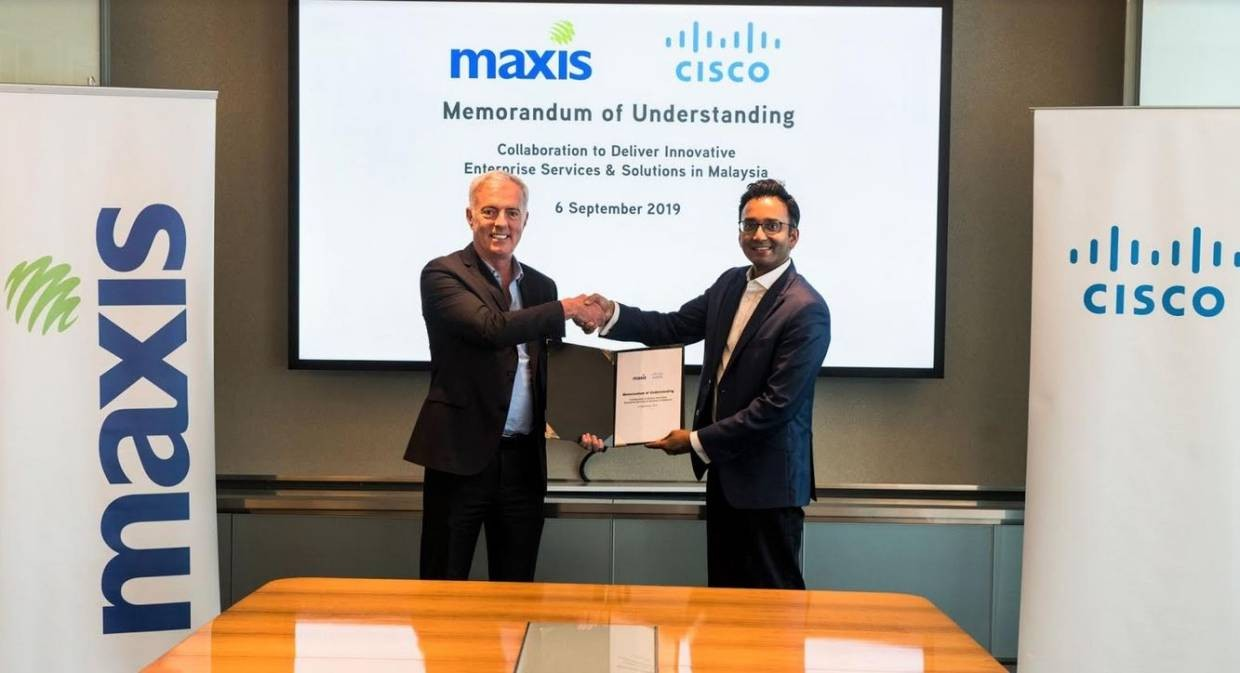 Maxis' chief enterprise business officer Paul McManus and the president of Cisco Asean, Naveen Menon shaking hands after the recent signing of the MoU. The collaboration would enable Maxis to be the country's top leading converged ICT solutions provider for enterprise, government and SMEs.