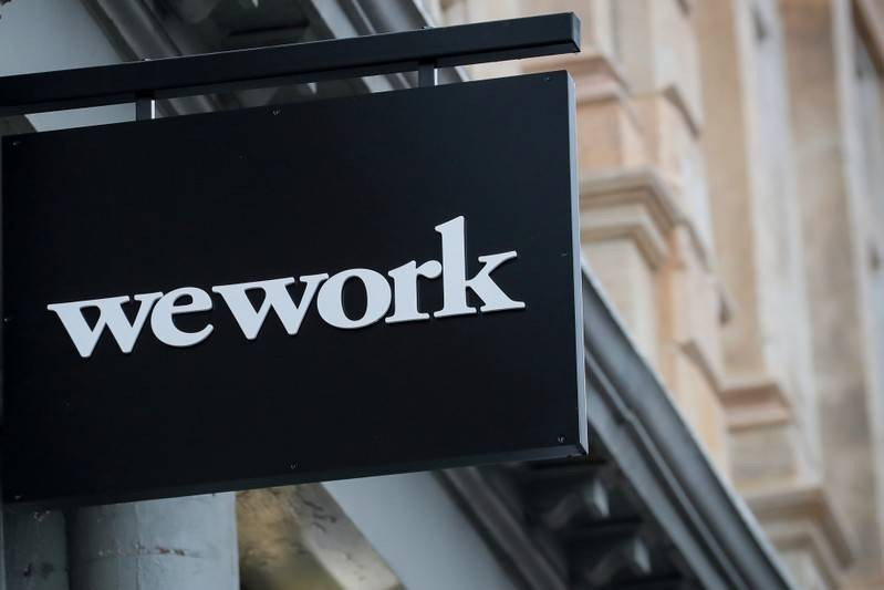 The WeWork logo is displayed outside of a co-working space in New York City, New York U.S., January 8, 2019. REUTERS/Brendan McDermid/Files