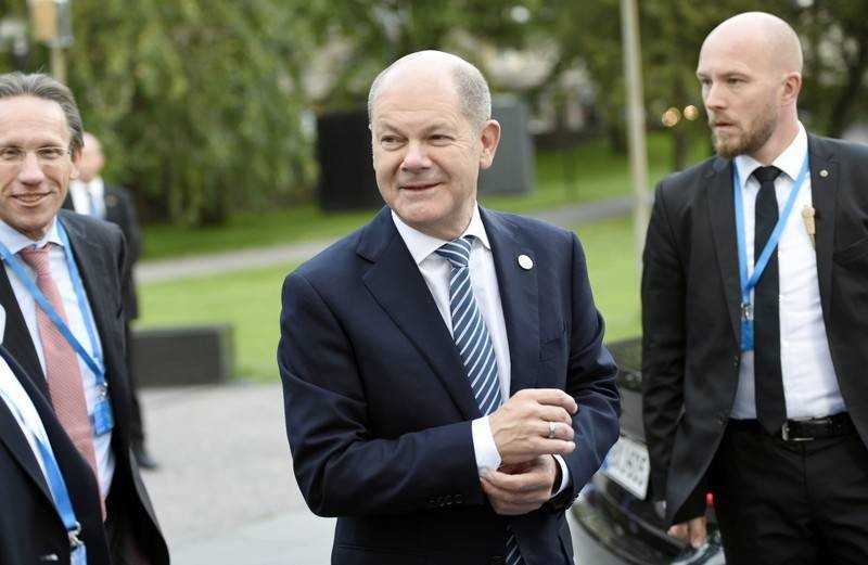 Scholz says he will remain as Germany's finance minister if he becomes SPD leader