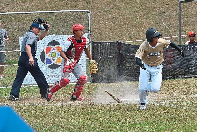 Japan's Kai Yamamoto (right) making his run after batting
