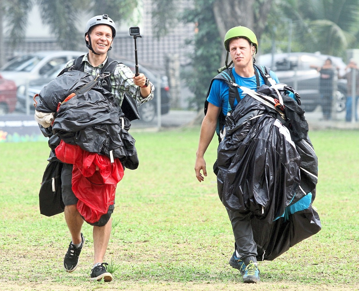 Base jumpers Ciesielski (left) and Filip Kubica from Poland reeling from their stunt at Gua Damai.